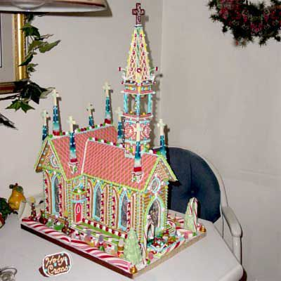 Detailed gingerbread Chruch with candy kane surroundings.