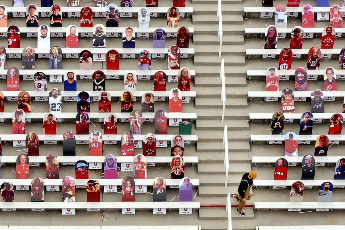 Cardboard cutouts of fans are seen in an empty Rice-Eccles Stadium at the University of Utah in Salt Lake City on Friday, Nov. 6, 2020. Utah's game against the University of Arizona scheduled for Saturday, Nov. 7, was canceled Friday due to a number of positive COVID-19 cases among student-athletes within the football program.