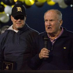 Jim McMahon with his former coach Lavell Edwards as his number is retired during halftime at Roy High School in Roy on Friday, Sept. 16, 2011.