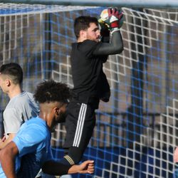 Goalkeeper Will Steiner goes up to make a save against his former team as a guest player for Steel FC