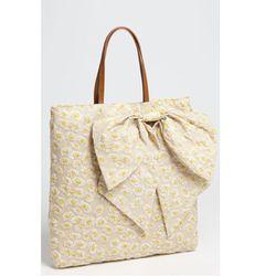 "<a href=""http://shop.nordstrom.com/s/red-valentino-daisy-print-bow-tote/3385946?origin=keywordsearch&contextualcategoryid=0&fashionColor=&resultback=0"">RED Valentino Daisy Print Bow Tote</a> $350, Nordstrom.com"