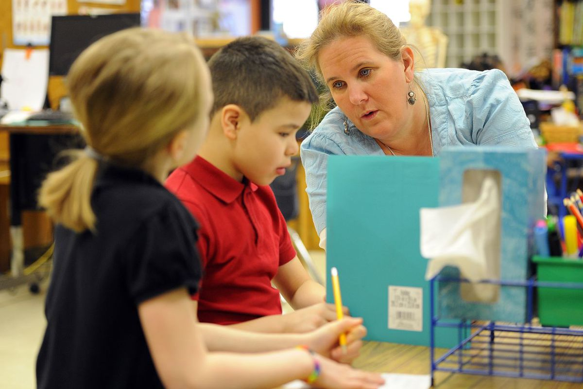 A teacher works with her students at IPS School 27, a Center for Inquiry school.
