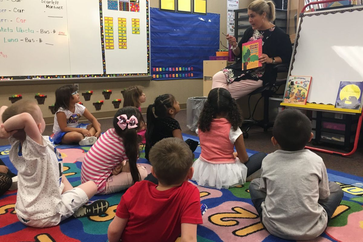 """Stout Field Elementary School kindergarten teacher Mandy Sequin reads """"Chicka Chicka Boom Boom"""" to her class on the first day of school."""