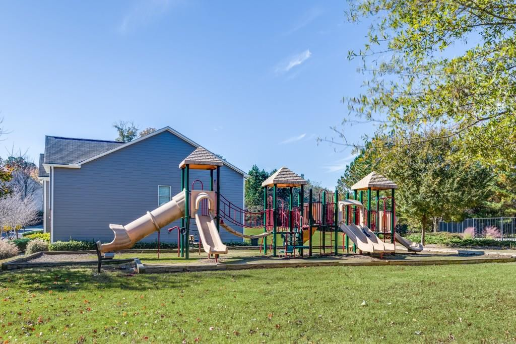 A large playground at a townhome community.