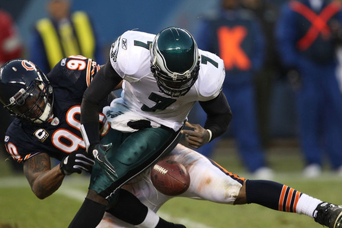 CHICAGO - NOVEMBER 28: Michael Vick #7 of the Philadelphia Eagles fumbles the ball as he is sacked by Julius Peppers #90 of the Chicago Bears at Soldier Field on November 28 2010 in Chicago Illinois. (Photo by Jonathan Daniel/Getty Images)
