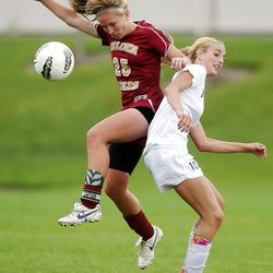 Timpanogos's #10 Breanna Brown, right, and Maple Mountain's #25 SciErra Woods work to control the ball during play Tuesday, Sept. 25, 2012. Maple Mountain won 2-1.