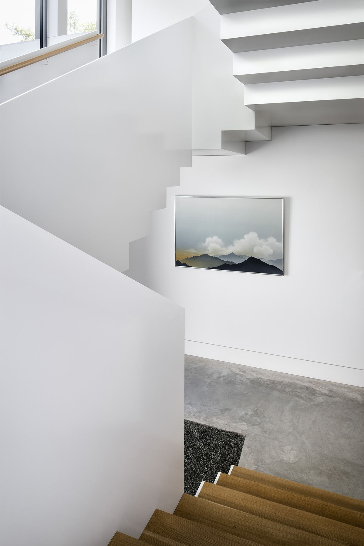 Staircase with white walls and oak steps