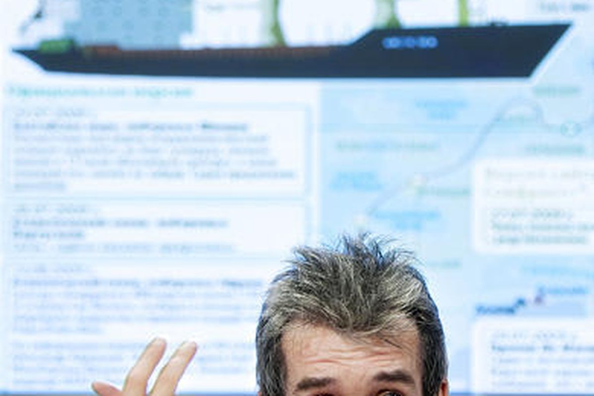Mikhail Voitenko, the editor of the online Maritime Bulletin-Sovfracht, speaks to the press in Moscow Tuesday with a big screen showing a picture of the Arctic Sea freighter. Voitenko, whose company Sovfracht specializes in anti-piracy security consulting