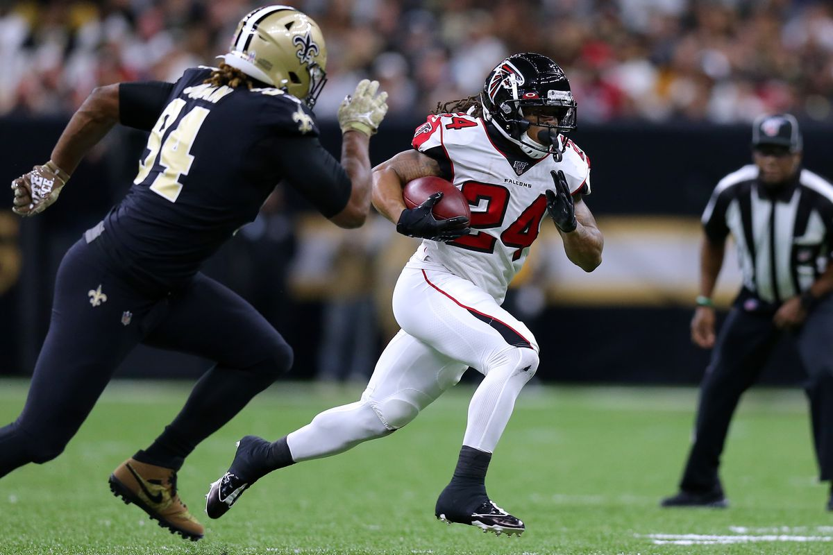 Devonta Freeman of the Atlanta Falcons runs with the ball during a game against the New Orleans Saints at the Mercedes Benz Superdome on November 10, 2019 in New Orleans, Louisiana.