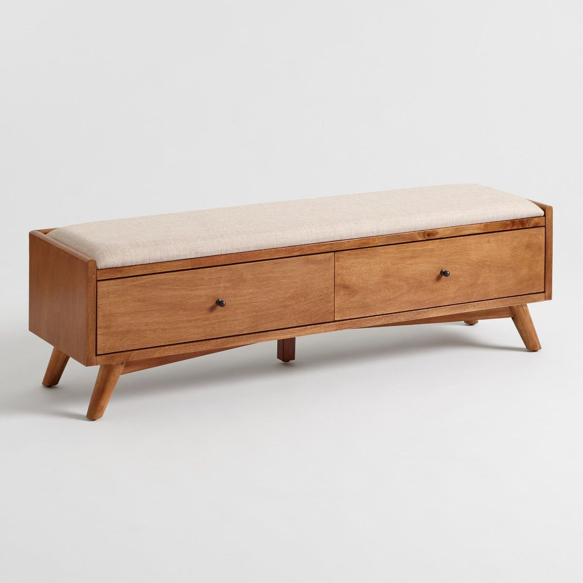 Low wooden bench with upholstered seat.
