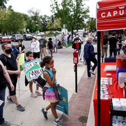People gathering for a protest get free snacks and drinks from Caputo's Market and Deli across from Pioneer Park in Salt Lake City on Saturday, June 13, 2020. The day's demonstrations were the latest in ongoing protests against racism and police brutality that have followed the killing of George Floyd in Minneapolis.