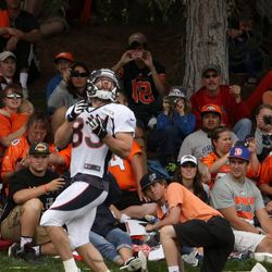 Broncos WR Wes Welker leans back just enough to let the pass drop in.