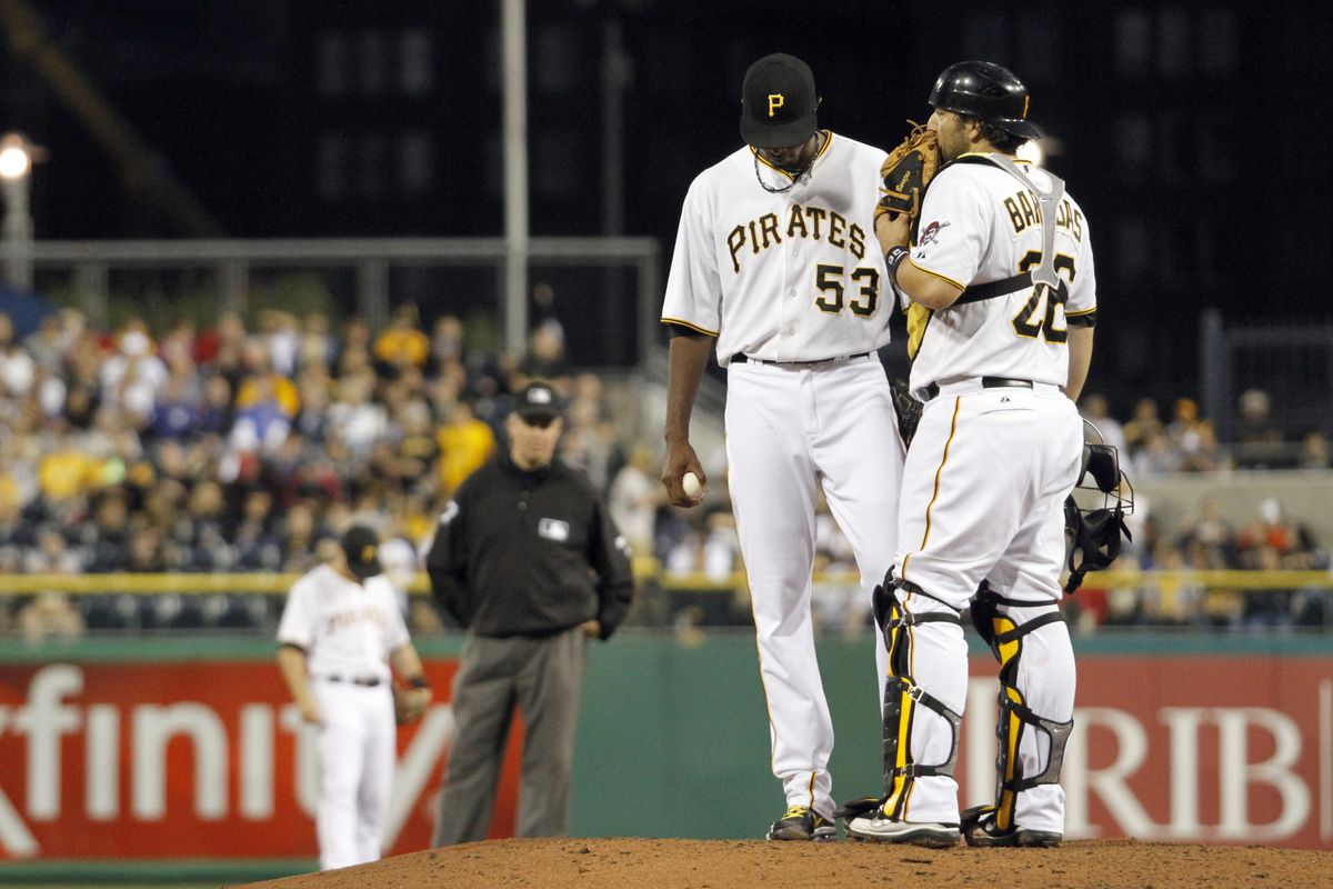 PITTSBURGH, PA - SEPTEMBER 8:  James McDonald #53 and Rod Barajas #26 of the Pittsburgh Pirates talk against the Chicago Cubs during the game on September 8, 2012 at PNC Park in Pittsburgh, Pennsylvania.  (Photo by Justin K. Aller/Getty Images)