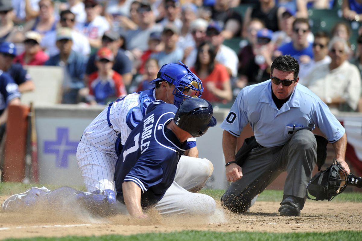 Chase Headley of the San Diego Padres is tagged out at home plate  by Blake Lalli of the Chicago Cubs  in Chicago, Illinois.  (Photo by David Banks/Getty Images)