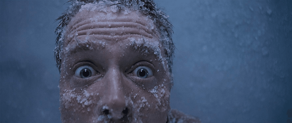 Michael J. Fox's face, frozen and beaded with ice, in extreme close-up, in The Frighteners