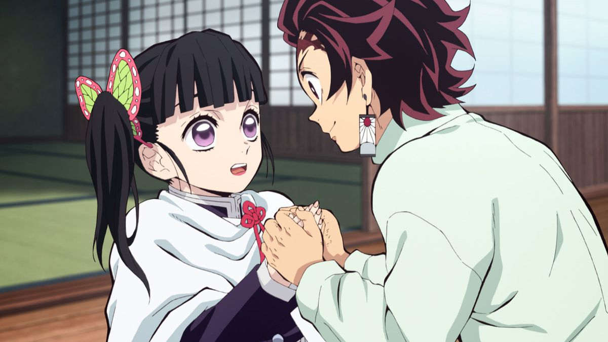Tanjiro sweetly holding the hands of his friend.