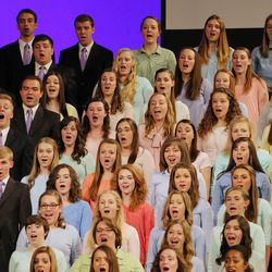 Choir members sing during the Worldwide Devotional for Young Adults from the Tabernacle on Temple Square in Salt Lake City Sunday, May 1, 2016.