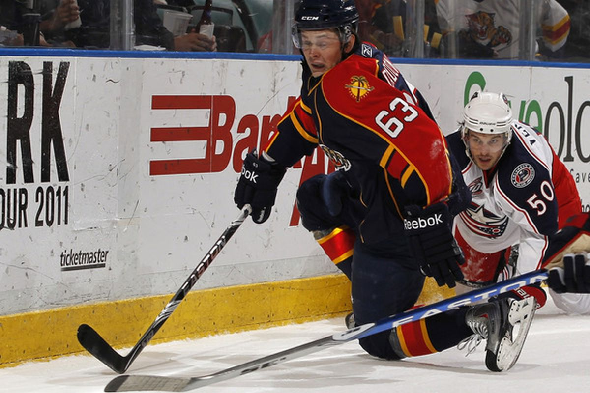 SUNRISE FL - JANUARY 19: Antoine Vermette #50 of the Columbus Blue Jackets checks Evgeny Dadonov #63 of the Florida Panthers off the puck on January 19 2011 at the BankAtlantic Center in Sunrise Florida. (Photo by Joel Auerbach/Getty Images)