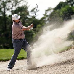 Andres Gonzales hits from a bunker during round three of the Korn Ferry Tour's Utah Championship at Oakridge Country Club in Farmington on Saturday, June 27, 2020.
