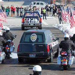 Unified police officer Doug Barney's funeral procession leaves the Maverik Center in West Valley City Monday, Jan. 25, 2016.