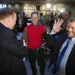 State Sen. Jim Dabakis and his husband, Stephen Justesen celebrate after being married by Salt Lake City Mayor, Ralph Becker as hundreds turn out to obtain marriage licenses Friday, Dec. 20, 2013 in the Salt Lake County offices after a federal judge ruled that Amendment 3, Utah's same-sex marriage ban, is unconstitutional.