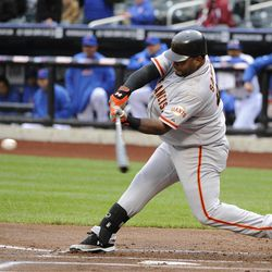 San Francisco Giants' Pablo Sandoval  hits an RBI single off of New York Mets pitcher Miguel Batista in the first inning of a baseball game on Monday, April 23, 2012, at Citi Field in New York.