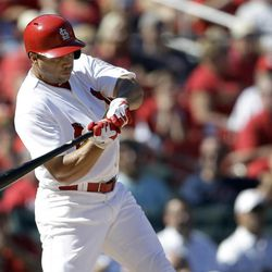 St. Louis Cardinals' Carlos Beltran hits a two-run double during the sixth inning of a baseball game against the Houston Astros Thursday, Sept. 20, 2012, in St. Louis.