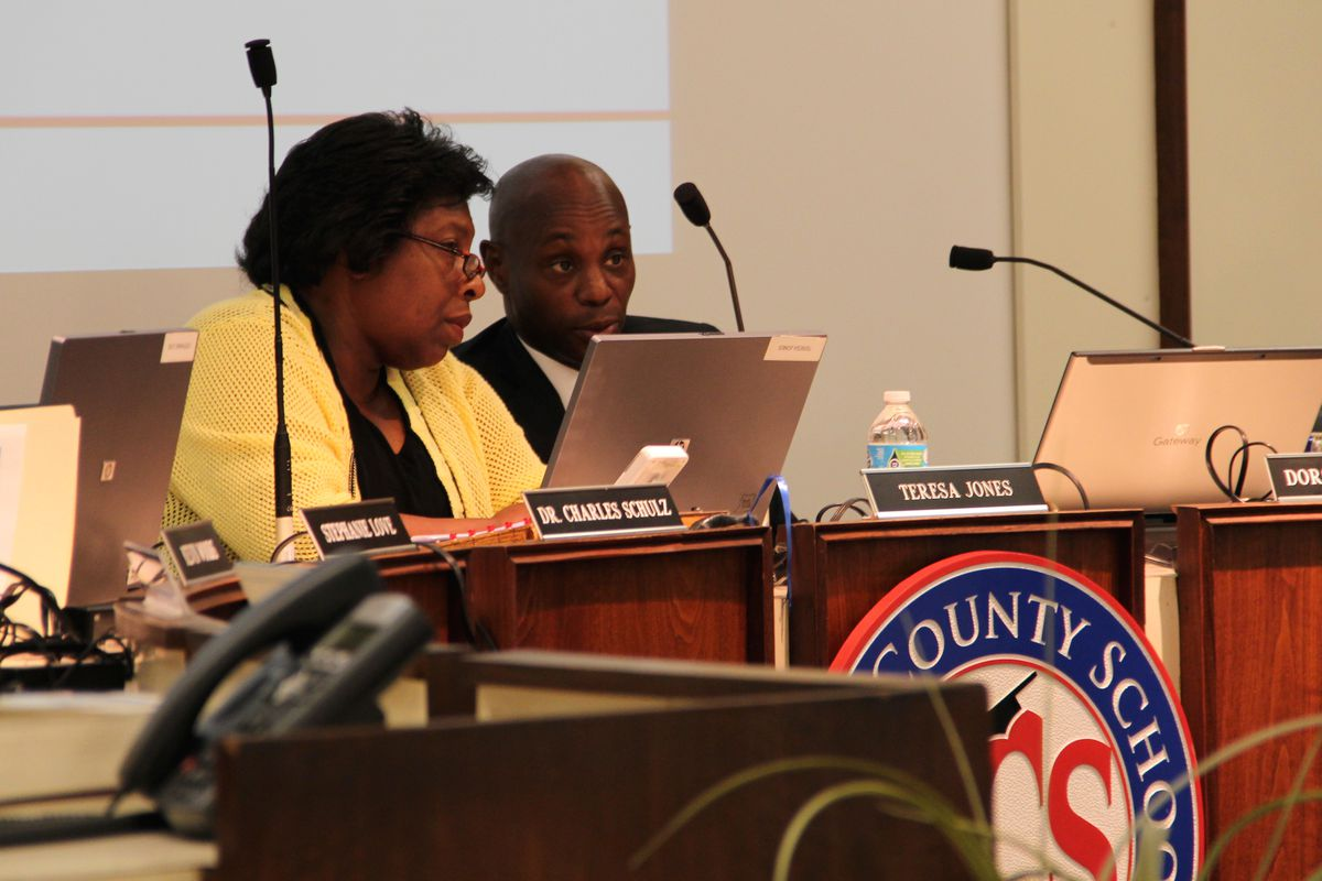 Former Shelby County Board of Education Chairwoman Teresa Jones confers with then Superintendent Dorsey Hopson during a 2015 school board meeting. Jones' seat is now up for an interim appointment.