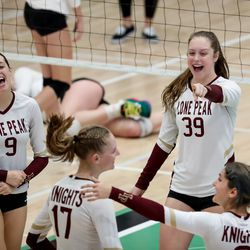 Lone Peak celebrates a point over Fremont in a 6A volleyball state semifinals game at Hillcrest High School in Midvale on Friday, Nov. 6, 2020.