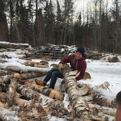 Elder Eli Peterson helps move a log so he and others can chop it up for a family with a wood burning stove in Thunder Bay, Ontario. A Canadian from Edmonton, Alberta, Peterson served in Thunder Bay during part of his nine-month wait for an R-1 religious workers visa so he could travel to the United States and serve as a Mormon missionary in Minnesota.