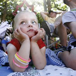 Macy Smith, 3, watches the Days of  '47 Parade move through downtown Salt Lake City on Saturday.