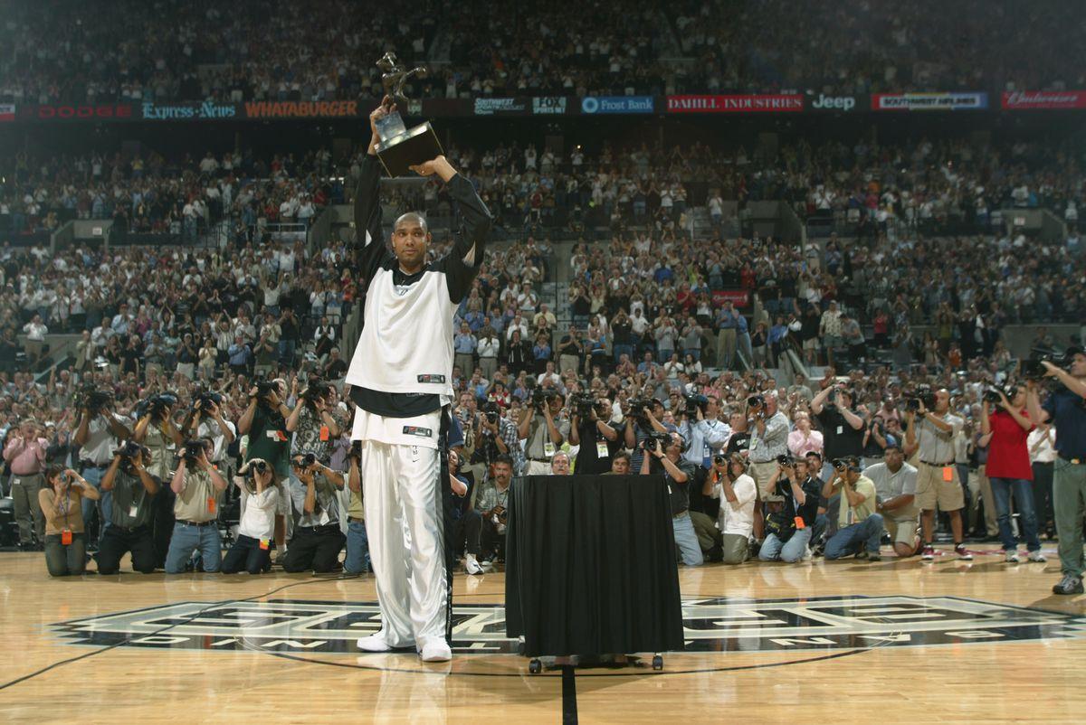 Tim Duncan raises MVP Trophy