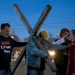 """Noah Gibson, 18, of Branson, Mo., second from right, receives a blessing from Dan Doktor, Austin Medina, Alan Johnson and Gary Don Holly, left to right, in Washington, D.C., on Thursday, Jan. 19, 2017. Doktor said the four came to """"ask God to have his spirit and peace flow over the nation and this Capitol,"""" during the inauguration."""