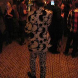 Holy crap! Crazy-suit guy outside his natural Fashion Week habitat!