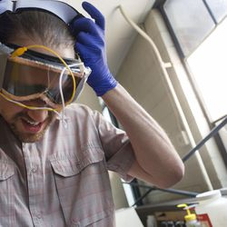 University of Utah student Simone Longo puts on a pair of prototype goggles in the Chemical and Mechanical Engineering Building on the U. campus in Salt Lake City on Thursday, June 1, 2017. The googles employ new technology that allows them to dim electrochemically.