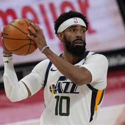 Utah Jazz guard Mike Conley looks to pass during the first half of an NBA basketball game against the Detroit Pistons, Sunday, Jan. 10, 2021, in Detroit.
