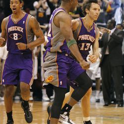 Sun's Steve Nash celebrates with Michael Redd after hitting the winning basket with 1.7 seconds left as the Utah Jazz are defeated by the Phoenix Suns 107-105 as they play NBA basketball Wednesday, April 4, 2012, in Salt Lake City, Utah.