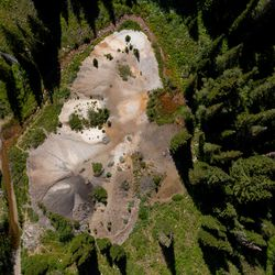 Water flows out of an old mine shaft and past a pile of tailings, the waste rock left over from mining, in Mill D South Fork of Big Cottonwood Canyon on Wednesday, Aug. 12, 2020.