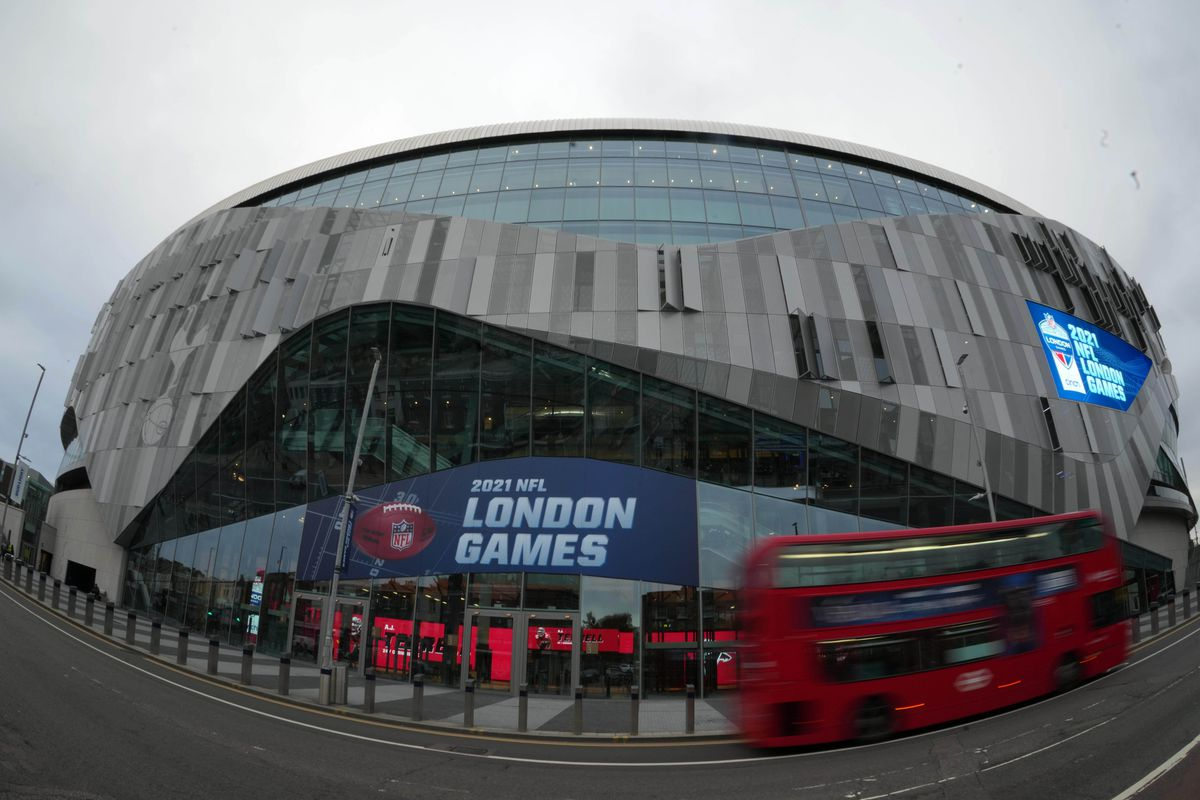 A general overall view as a red double decker bus passes by Tottenham Hotspur Stadium, the site of the 2021 NFL London Games featuring the New York Jets and the Atlanta Falcons (Oct. 10) and the Miami Dolphins and Jacksonville Jaguars (Oct. 17).