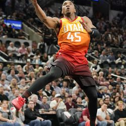 Utah Jazz's Donovan Mitchell shoots during the second half of the team's NBA basketball game against the San Antonio Spurs, Friday, March 23, 2018, in San Antonio. San Antonio won 124-120 in overtime. (AP Photo/Darren Abate)
