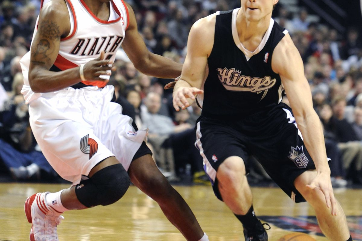 Sacramento Kings' Jimmer Fredette, right, drives against Portland's Nolan Smith during game in Portland, Ore., Tuesday, Dec 27, 2011.