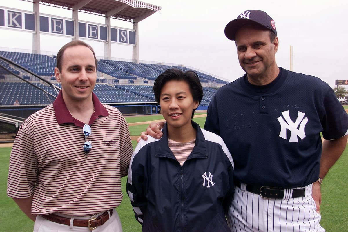 Yankees GM Brian Cashman, assistant GM Kim Ng, and manager Joe Torre