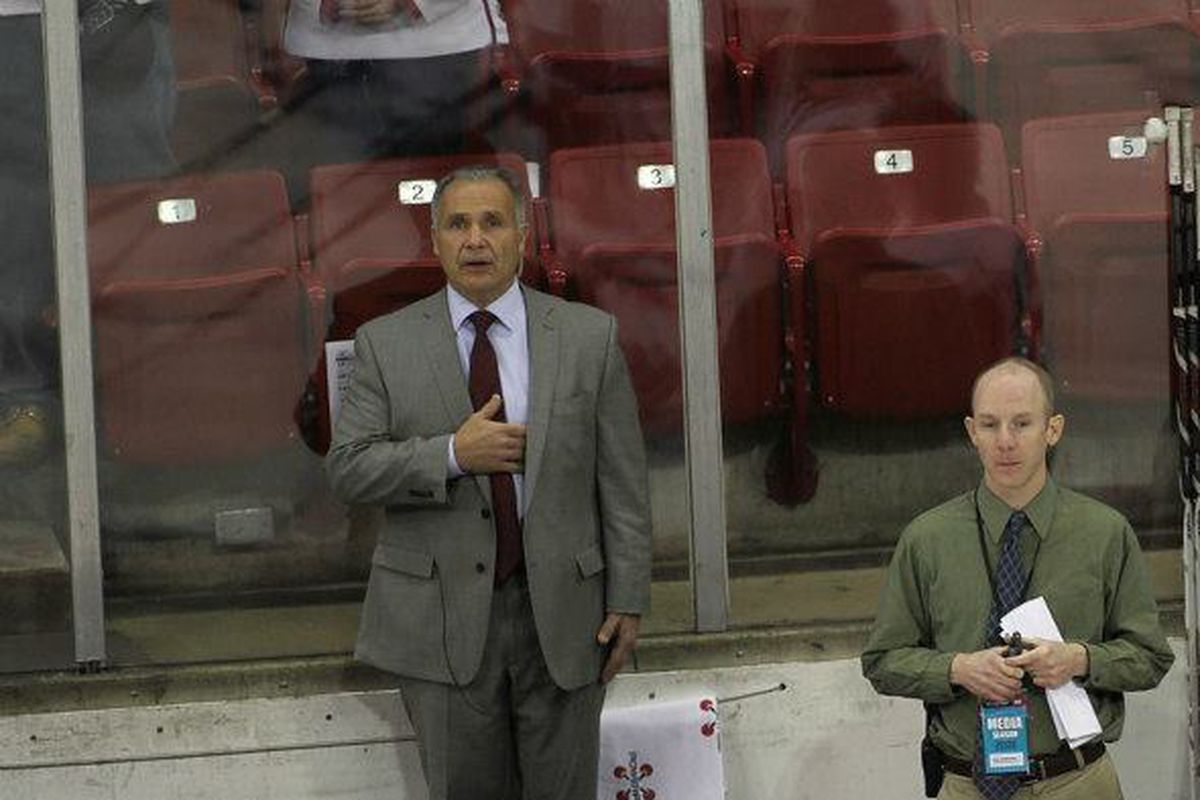 Badger assistant coach Bill Butters (bench, far left) has stepped down from his position at Wisconsin.