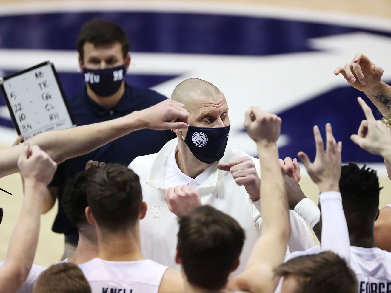 Brigham Young Cougars head coach Mark Pope talks with the team.