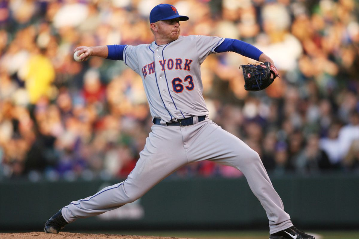 April 27, 2012; Denver, CO, USA; New York Mets pitcher Chris Schwinden (63) delivers a pitch during the first inning against the Colorado Rockies at Coors Field. Mandatory Credit: Chris Humphreys-US PRESSWIRE