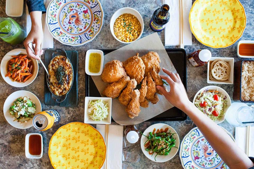 A big table for fried chicken and lots of sides.