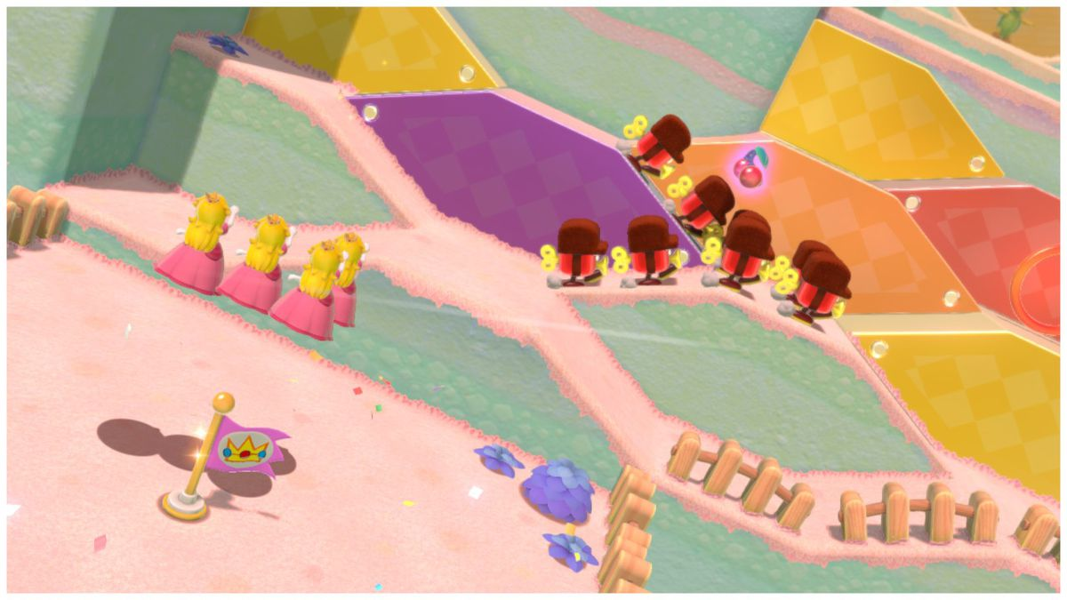 Four Princess Peach clones jump towards enemies on a series of hills in Super Mario 3D World.