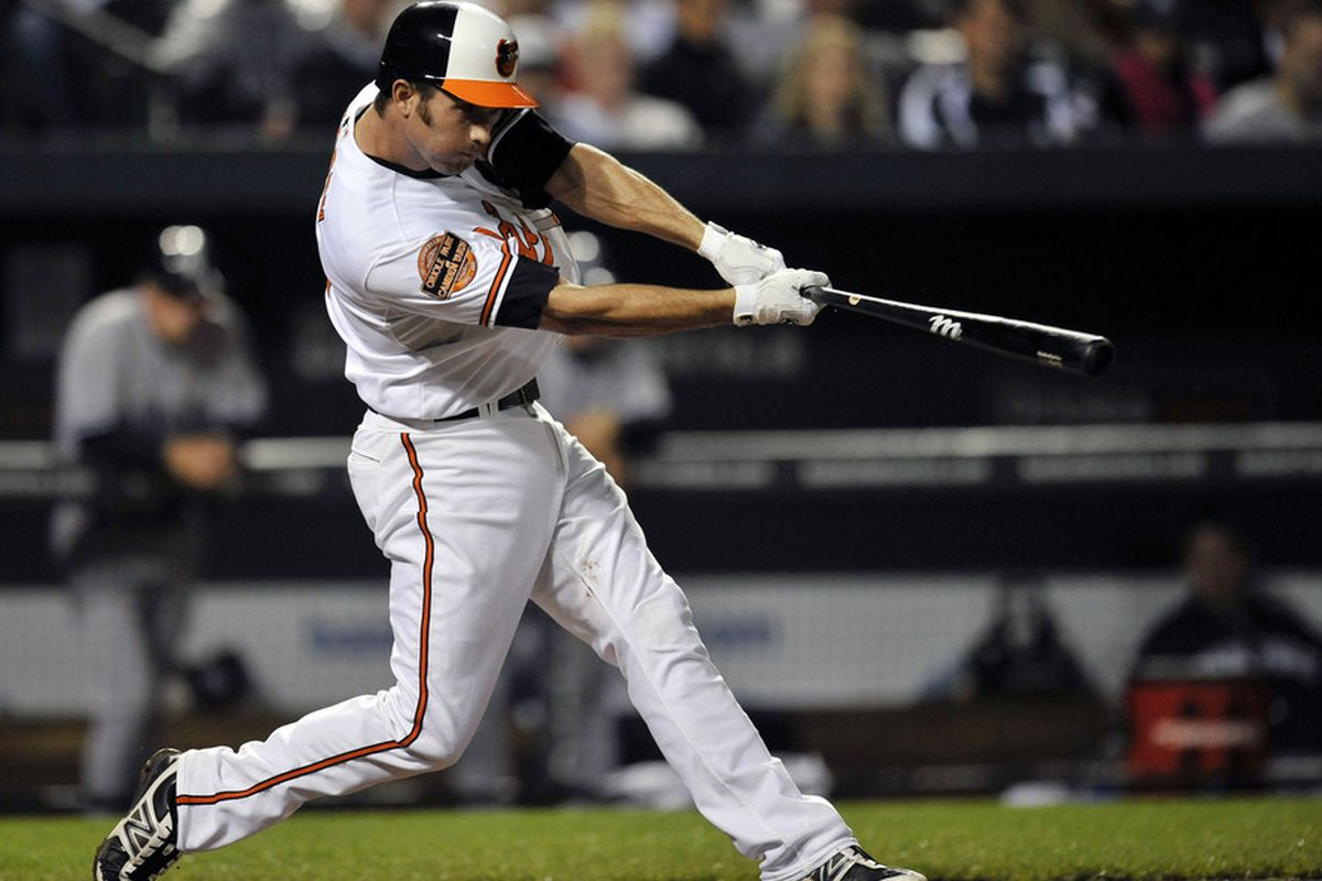 May 14, 2012; Baltimore, MD, USA; Baltimore Orioles shortstop J.J. Hardy (2) hits a two-run home run in the fifth inning against the New York Yankees at Oriole Park at Camden Yards.