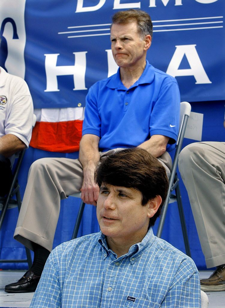 Speaker of the House Michael Madigan, D-Chicago, top and then- Gov. Rod Blagojevich, bottom, attend the Illinois State Fair in Springfield in 2007. File Photo. (AP Photo/Seth Perlman)