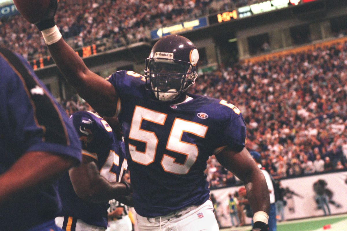 Minneapolis, MN 10/3/99 Vikings vs. Tampa Bay Buccaneers — Corey Miller celebrates after intercepting a Tampa pass late in the fourth quarter, as Tampa was getting close their goal in an effort to tie the game. The Vikings won, 21-14.